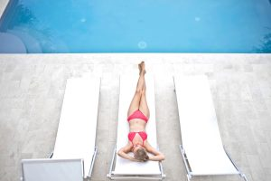 Woman Lying on White Sun Lounger